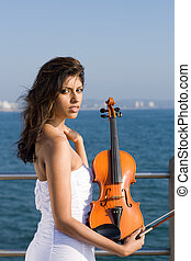 indian violin player - an indian violin player on pier...