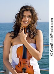 indian violinist - an indian woman in dress holding violin