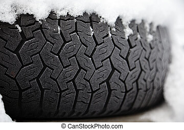 Winter tyre - Car tyre frosted and covered with snow Shallow...