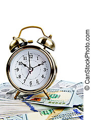 alarm clock over money
