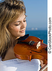 beautiful violinist - a beautiful violinist playing near...