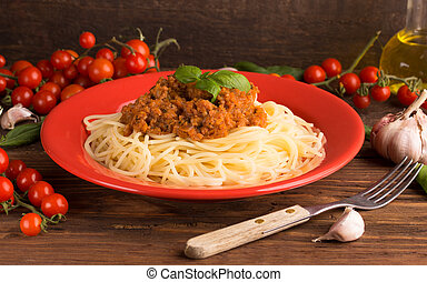 spaghetti bologneze with food ingredients
