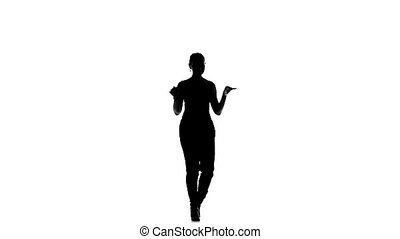 Young social latin dancer girl making moves dancing, on white, slow motion, silhouette