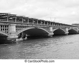 Black and white Blackfriars bridge in London - Blackfriars...