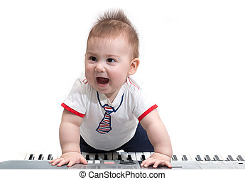 Little baby with electric piano - Little baby enjoying...