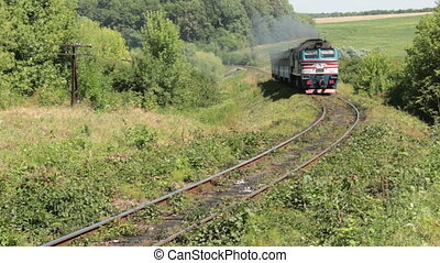 Train-diesel - Diesel passenger train moves outdoors