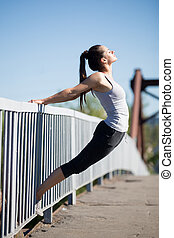Street yoga: backbend - Yoga in the city: beautiful young...