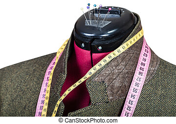 tailoring of male green tweed jacket on mannequin isolated...