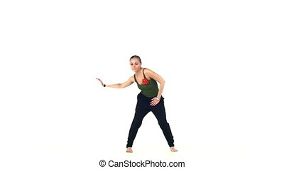 Beautiful young lady dancing social latin dance, slow motion...