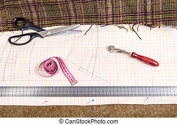 cutting table with cloth, pattern, tailoring tools