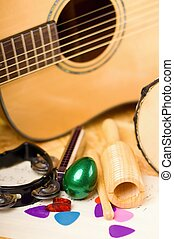 Vertical photo of egg shaker among other instruments -...