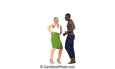 Couple of social latino dancers go on dancing on white, slow...