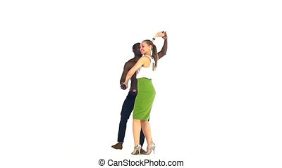 Couple of social latino dancers starting dancing on white, slow motion