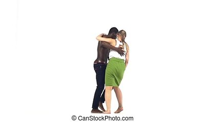 Professional couple of social latin dancers starting dancing on white, slow motion