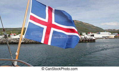 Boat leaving Iceland Bay with Flag - Boat leaving Iceland...