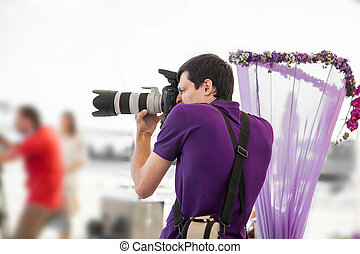 wedding photographer in action - Wedding photographer taking...