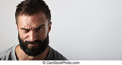 Portrait of an ironic bearded man - Close-up portrait of a...