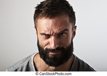 Portrait of an ironic bearded guy - Close-up portrait of a...