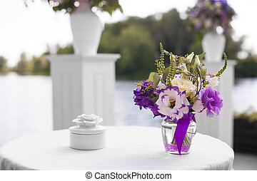 flowers at the wedding - purple bouquet of flowers for a...