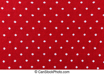 Red knit fabric with polka dot texture background