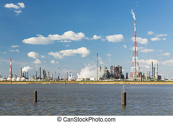 Antwerp Harbor Refinery And Flare Stack - A refinery with...