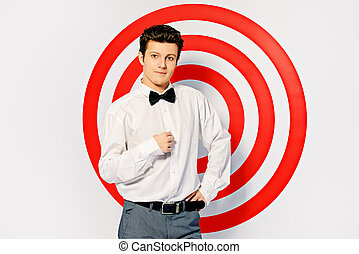 spy man - Elegant handsome man posing by a red shooting...