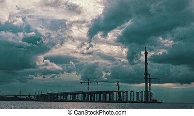 Dramatic Clouds over a Bridge Under Construction, timelapse