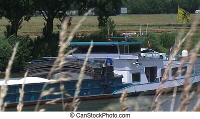 Barge sailing upstream in Dutch River landscape - close up -...