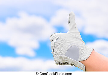 hand gesture against the sky in a glove golf