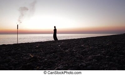 silhouette of girl at sunset going to the torch - girl at...