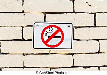 No smoking sign on brick wall