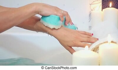 Woman wash her hands in a bath with foam. Slowmotion...