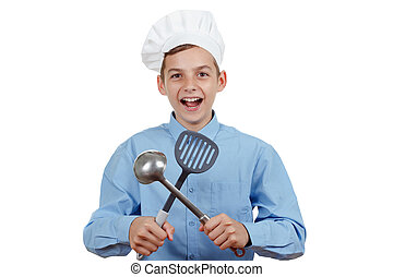 Young cheerful teenager with ladle and humor in a chef's hat. Isolated studio