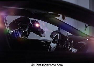 Car Robber with Flashlight Looking Inside the Car. Car...