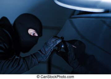 Motor Vehicle Theft Photo Concept. Car Theft in Black Gloves...