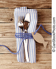 Fish knive and fork Tied on Napkin with Tag on the Table -...