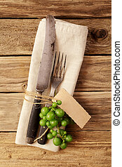 Horizontal cutlery with empty tag for autumn cuisine concept...