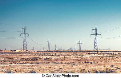Power lines pylons - Rows of high voltage power line pylons...