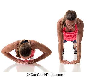 Push Up Variation - Push-up exercise variation. Studio shot...