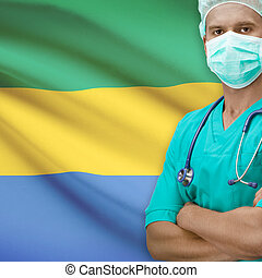 Surgeon with flag on background series - Gabon - Surgeon...
