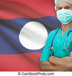 Surgeon with flag on background series - Laos - Surgeon with...