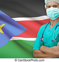 Surgeon with flag on background series - South Sudan -...