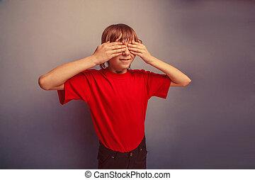 boy, teenager, twelve years in red T-shirt, eyes closed...