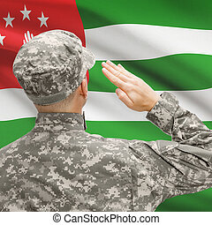 Soldier in hat facing national flag series - Abkhazia -...