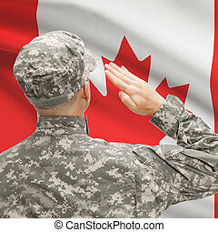 Soldier in hat facing national flag series - Canada -...