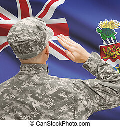 Soldier in hat facing national flag series - Cayman Islands...