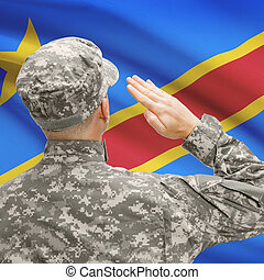 Soldier in hat facing national flag series - Congo-Kinshasa...