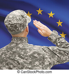 Soldier in hat facing national flag series - European Union...