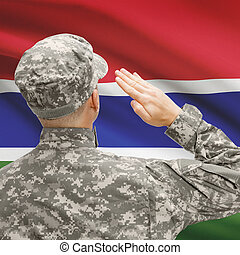 Soldier in hat facing national flag series - Gambia -...