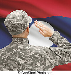 Soldier in hat facing national flag series - Laos - National...